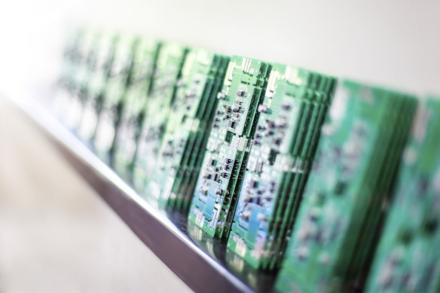 Large group of green silicone microchips in a row in a production line